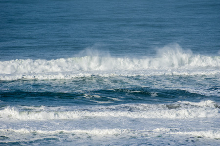 wind blown: Wind blown spray from breaking waves at the coast Stock Photo