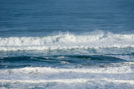 breaking waves: Wind blown spray from breaking waves at the coast Stock Photo