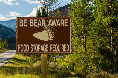 aware: Bear Aware sign in remote area warning sign