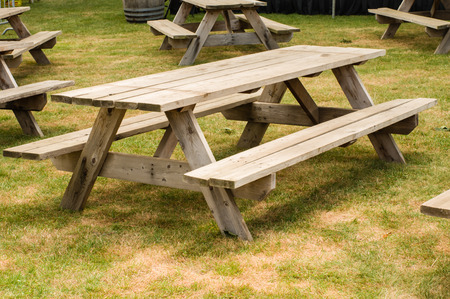 picnic: Group of wooden picnic tables in a grassy park