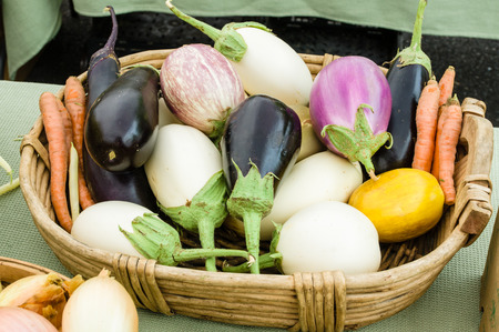 White and purple eggplant on display at the farm market