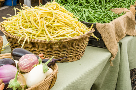 snap bean: Basket of yellow snap or string beans at the market Stock Photo