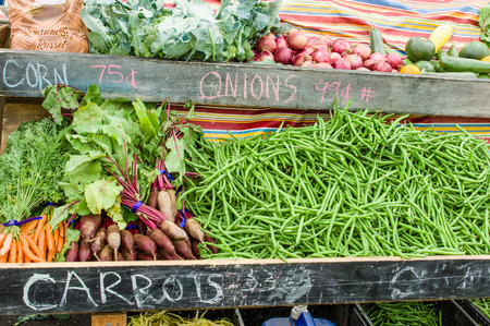 green beans: Display of carrots and beets at the farm market Stock Photo