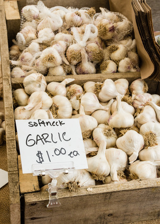 herbs boxes: Wooden box of white garlic on display at the market Stock Photo