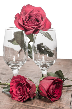 faded: Wine glasses and faded roses vintage look Stock Photo
