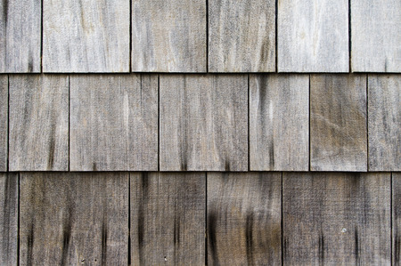 Weathered roof shingles made of cedar shakes Stock Photo