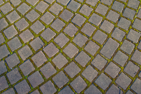 road surface: Pathway made of stone bricks in a pattern