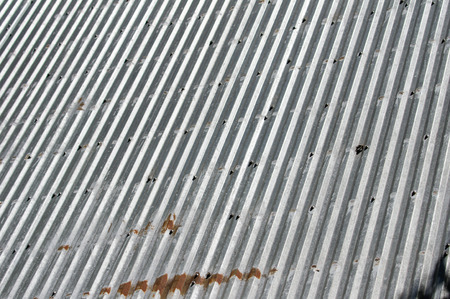sheeting: Rusted metal sheeting with ripples for use as background Stock Photo