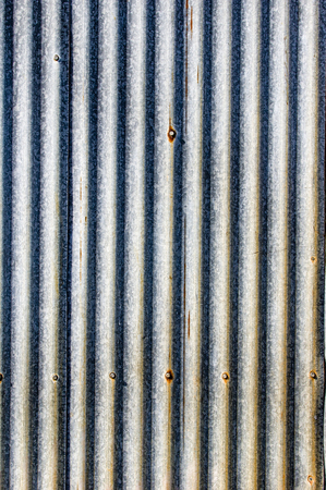 steel sheet: Rusted metal sheeting with ripples for use as background Stock Photo