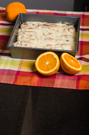 icing: Orange cinnamon sweet rolls with icing Stock Photo