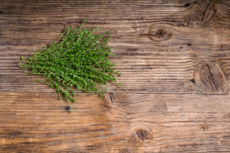 Freshly picked bundle of thyme on a wooden table
