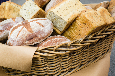 Basket of fresh artisan breads at the farmers market