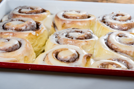 Pan of fresh baked cinnamon rolls with icing