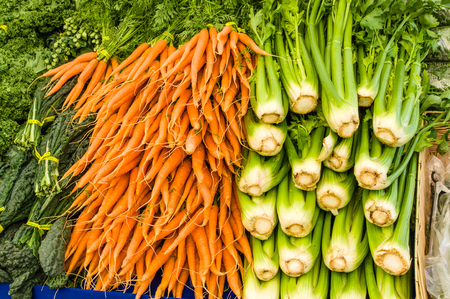 harvests: Fresh celery and orange carrots at the market