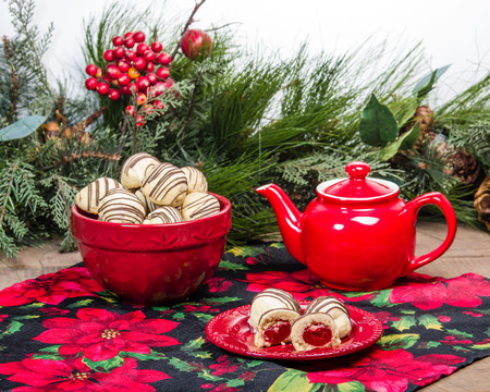 Holiday themed tea pot and filled Christmas cookies Stock Photo