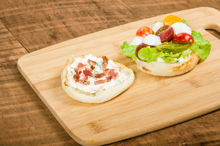 English muffin sandwich with cream cheese and heirloom tomatoes