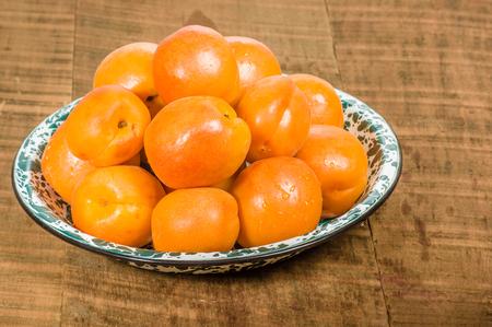 Bowl of ripe fresh yellow apricots