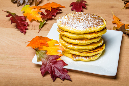 hotcakes: Fresh pancakes topped with powdered sugar with fall leaves