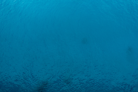 Water background with blue peaceful ripples for use as texture or background Stock Photo