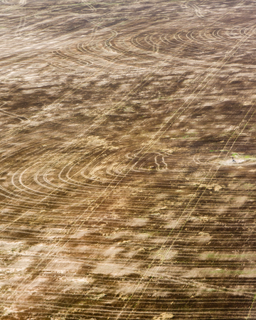Aerial view of brown fallow cropland that has been harvested