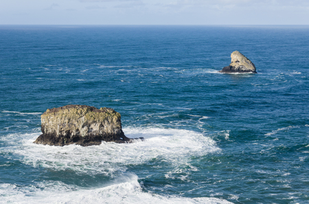 Pyramid Rock and Pillar Rock off Cape Meares Oregon are rocky outcrops in the Pacific Ocean