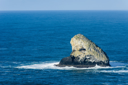 Pyramid Rock off Cape Meares Oregon is a rocky upthrusr in the Pacific Ocean