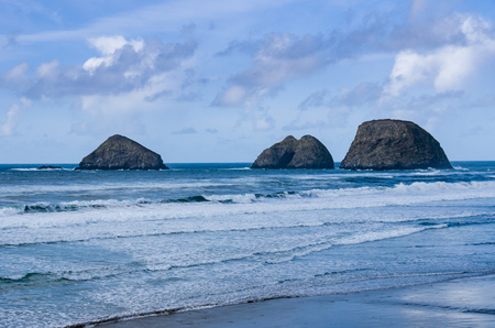 Storm, Finley and Shag Rocks in the Pacific Ocean near Oceanside Oregon Stock Photo