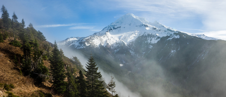 mt hood national forest: Fog rolling over the pass near snow capped Mt Hood Stock Photo
