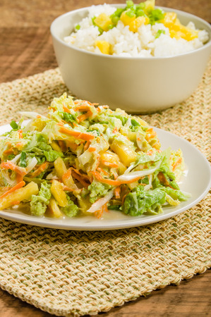 Fresh rice bowl with pineapple and scallions with an oriental chicken salad Stock Photo