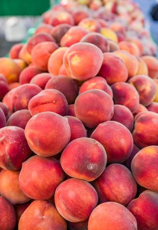 Fresh peaches at the farmers market display