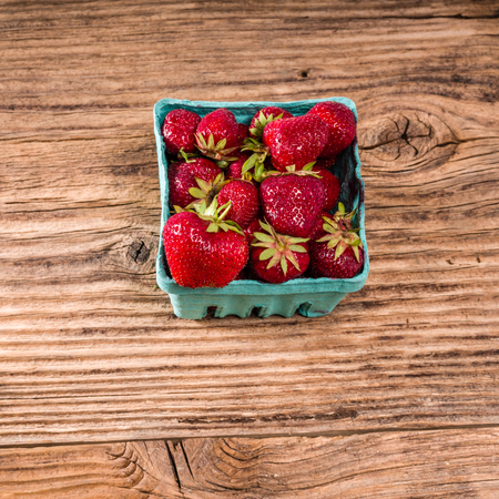 Small basket of fresh strawberries ready to eat