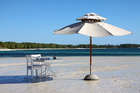 belle: Umbrella and table, Belle Mare Beach, Mauritius, Africa Stock Photo