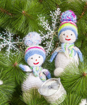 Knitted christmas toys on the christmas tree Stock Photo