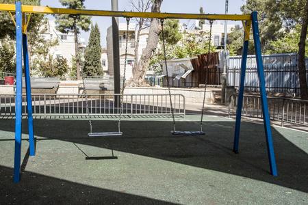 regret: Alone teeter in child playground,nostalgia, regret emotions