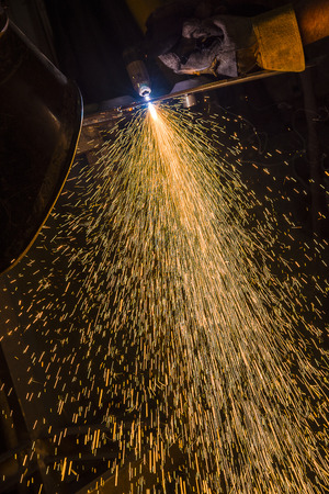 to maintain: Sparks from Welding, fireworks from the plasma welding Stock Photo
