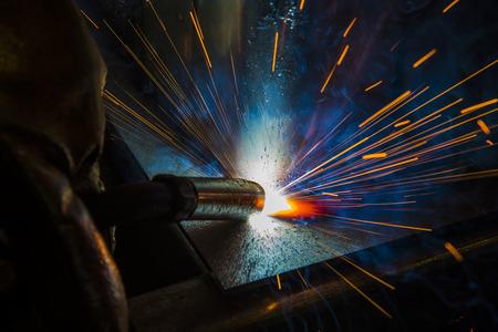 welded: welder, craftsman, erecting technical steel Industrial steel welder in factory technical,