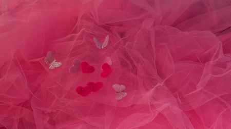hearts aspire on a red background. Concept of love, St. Valentines Day, lovers. Flat fly Valentines Day Love Stock Photo