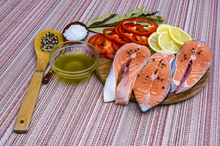 Salmon fillet with rosemary and lemon, preparing a red fish Stock Photo