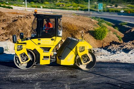 blacktop: Heavy Vibration roller at asphalt pavement works Asphalt paver road repair Asphalt paver road repair Stock Photo