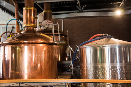 mini brewery, with brewing kettles, vessels, tubs and pipes made of stainless steel.