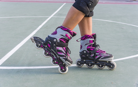 Roller skates feet close-up. Rollers on the legs of sports