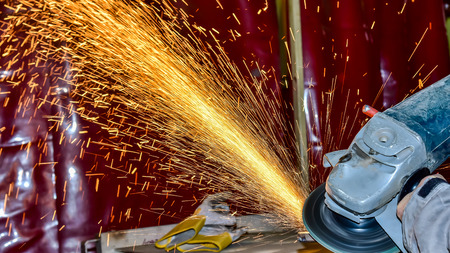 Grinding wheels polished Metal polishing grinding, Sprays from the processing metal Stock Photo