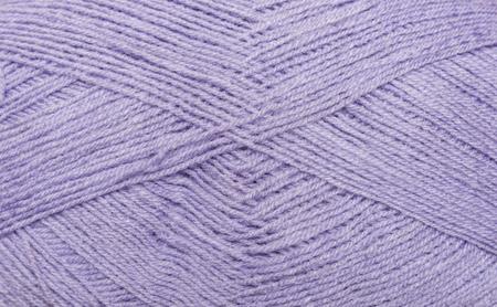 編むことのためバック グラウンド スレッドです。実際にカラフルな糸のウールのニット パターン。ニット用アクリル糸