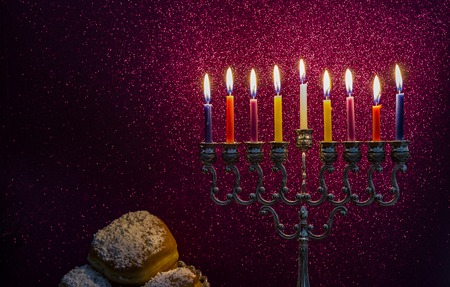Image of the Hanukkah Jewish holiday with a menorah and burning candles