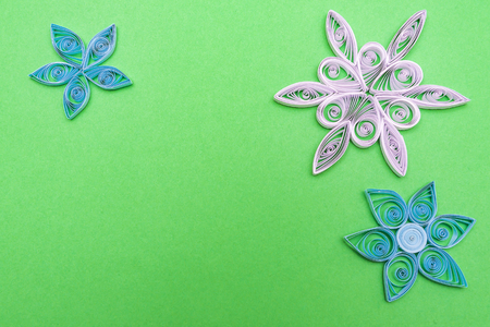 flowers made quilling on a light background quilling