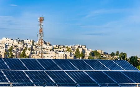 solar panels on the background of the city of Jerusalem Stock Photo