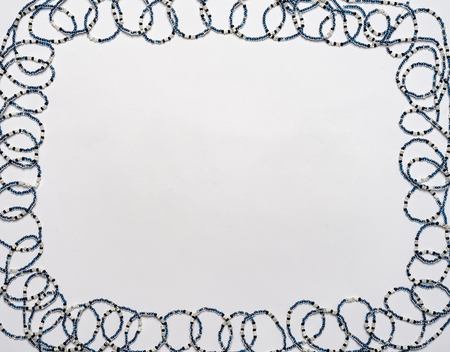 Frame from the typed beads to the string. Stock Photo