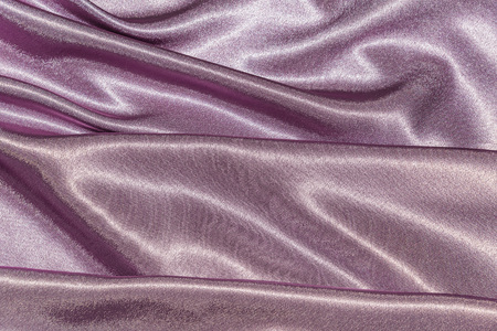 Beautiful smooth elegant wavy violet purple satin silk luxury cloth fabric texture, abstract background design. Card or banner. sewing material abstraction 版權商用圖片