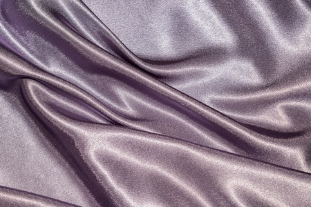 Beautiful smooth elegant wavy violet purple satin silk luxury cloth fabric texture, abstract background design. Card or banner. sewing material abstraction