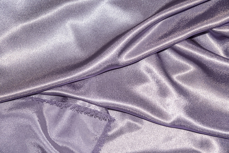 Beautiful smooth elegant wavy violet purple satin silk luxury cloth fabric texture, abstract background design. Card or banner. sewing material abstraction Archivio Fotografico
